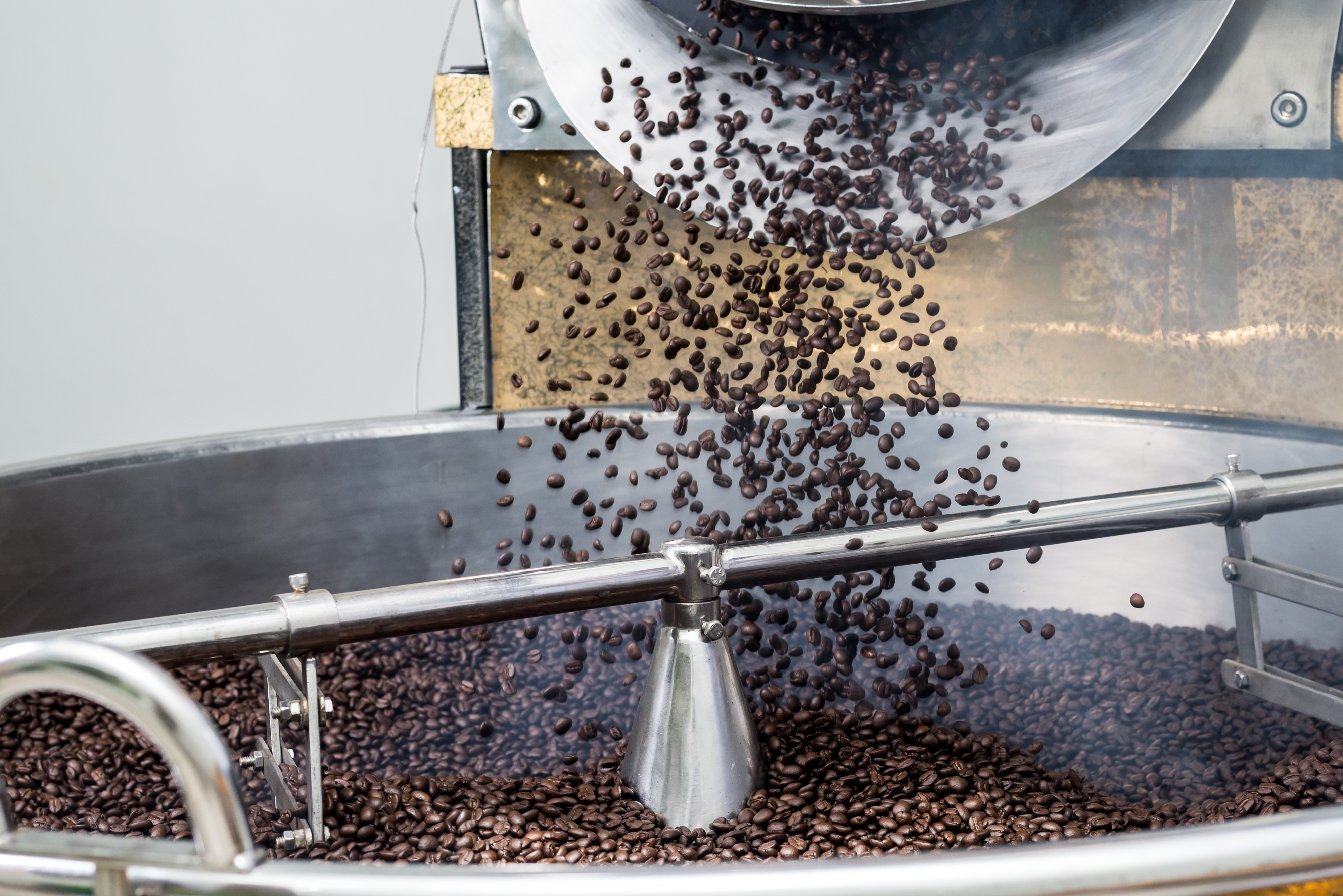 Coffee beans falling off roasting machine